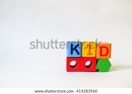 KID word written on wood blocks, white background with copyspace - stock photo