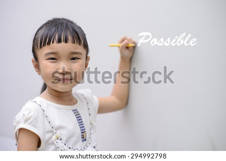 Kid write white possible word on wall with smiling face - stock photo