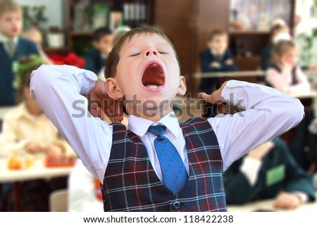 Kid yawning at the lesson - stock photo