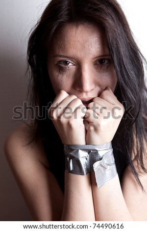 kidnapped young woman, hostage closeup on white background