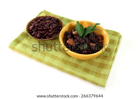 Kidney beans with fried bacon and fresh parsley - stock photo