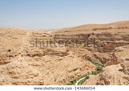 Kidron river valley. Panorama viewed from terrace of Greek Orthodox monastery The Great Lavra of St. Sabbas the Sanctified (Mar Saba) in Judean desert. Palestine, Israel.   - stock photo