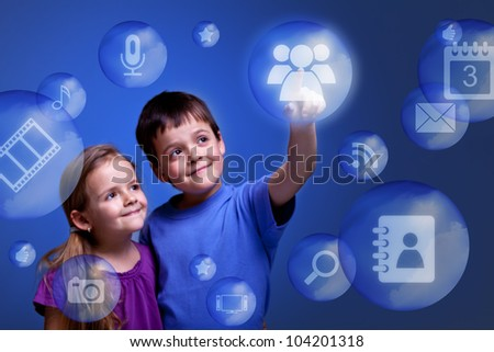 Kids accessing cloud computing applications on virtual three dimensional display - stock photo