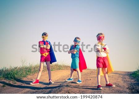 kids acting like a superhero retro vintage instagram filter - stock photo