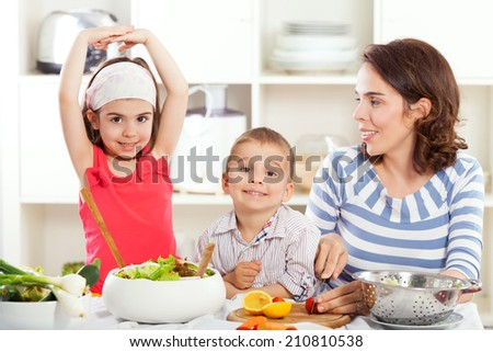 Kids and mother having fun in the kitchen