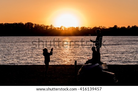 Kids are having fun in sunset
