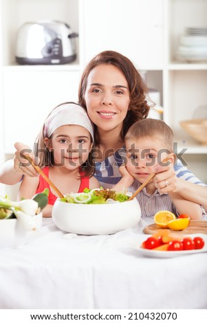 Kids are helping their mother to prepare healthy breakfast - stock photo