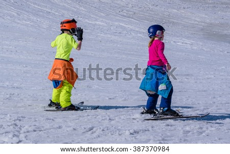 Kids are playing at ski hill