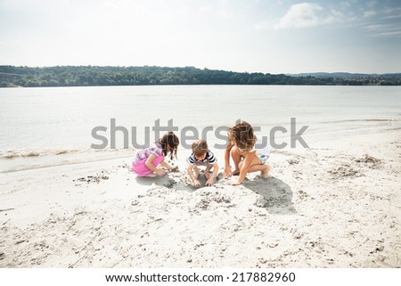 Kids are playing on the beach - stock photo