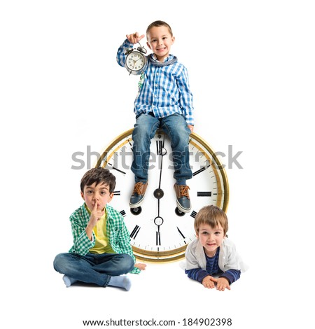 Kids around vintage clock over white background  - stock photo