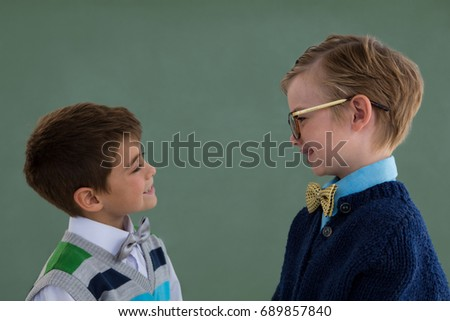 Kids as business executive smiling while standing in office