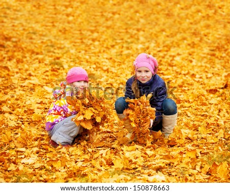 Kids at autumn park. Children happy