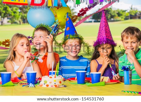 Kids at Birthday Party, Cake and Balloons - stock photo