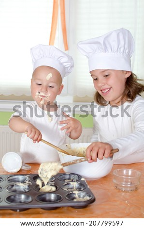 Kids at chef uniform baking Muffins for Mothersday