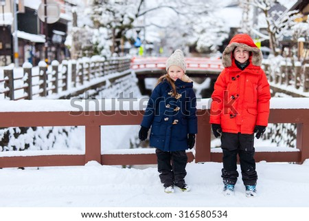 Kids at Takayama town in Japan on winter day - stock photo