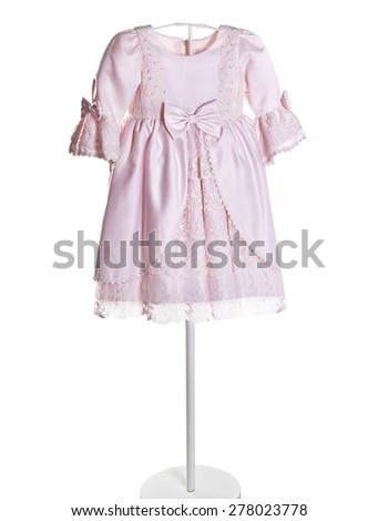 Kids beautiful pink dress for outdoor hanger. Isolated on a white background. - stock photo