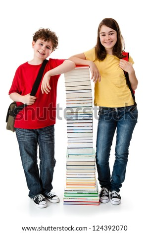 Kids behind pile of books on white background - stock photo