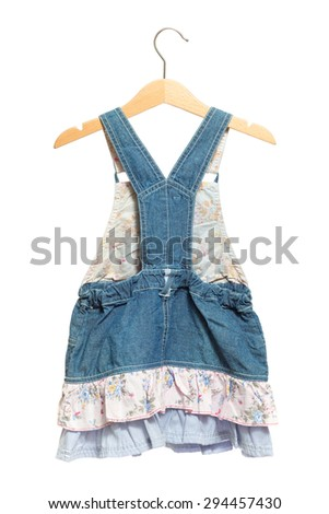 Kids blue bid Jeans dress back view in clothes hanger, isolated on white background.