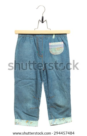 Kids blue jeans front view in clothes hanger, isolated on white background. - stock photo