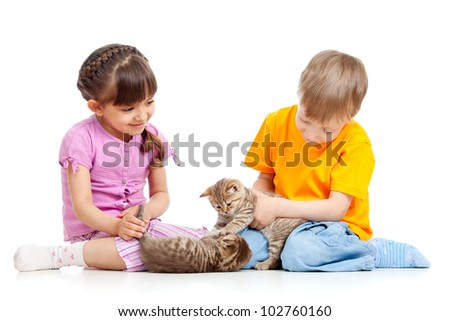 Kids boy and girl playing with kittens. Isolated on white background - stock photo
