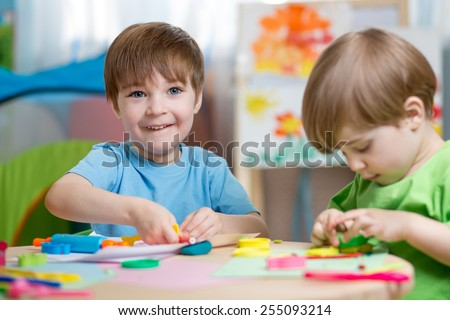 kids boys with play clay toys at home