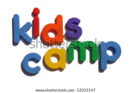 kids camp - colored fridge magnets on white background