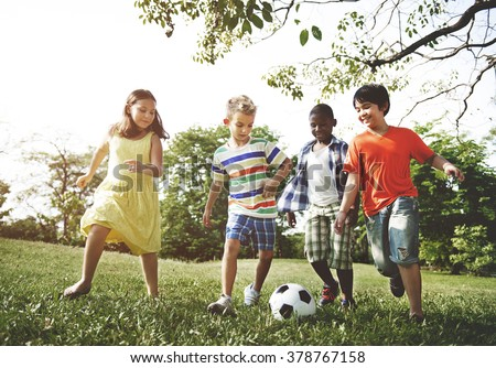 Kids Children Playing Football Fun Happiness Concept - stock photo