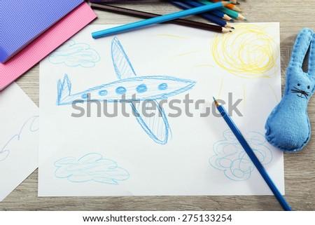 Kids drawing on white sheet of paper, closeup - stock photo