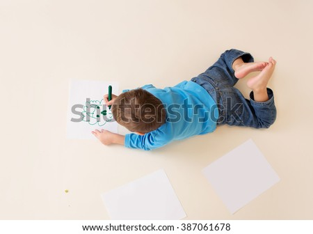 Kids drawing with markers, art concept. Preschoolers, kindergarteners. - stock photo