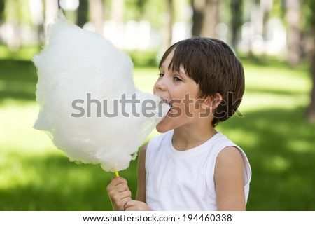 kids eating cotton candy - stock photo