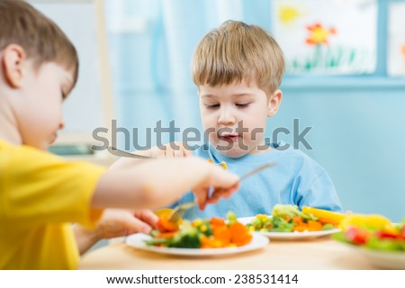 kids eating food in nursery or at home - stock photo