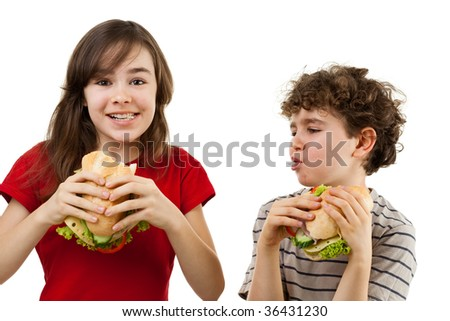 Kids eating healthy sandwiches isolated on white background