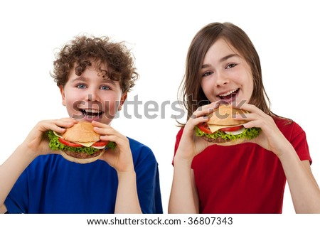 Kids eating healthy sandwiches isolated on white background - stock photo