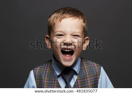 kids emotion.fashionable little boy.stylish funny child in suit and tie. fashion children
