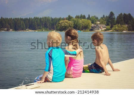 Kids enjoying summer vacation at the lake - stock photo