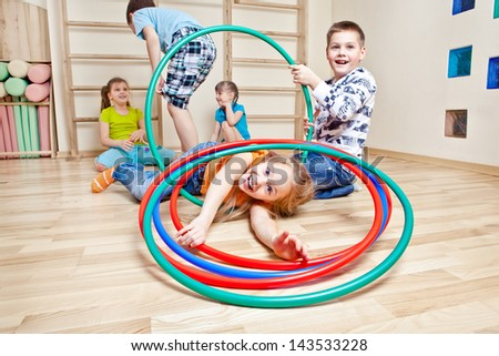 Kids enjoying their time in a gym - stock photo