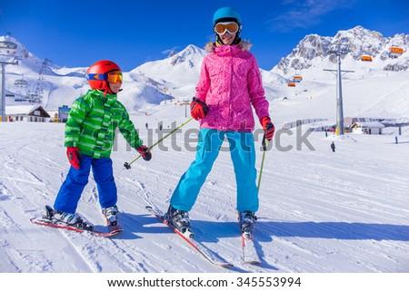 Kids enjoying winter vacation at ski resort - stock photo