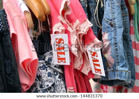 Kids Fashion labelled by a sale sign - stock photo