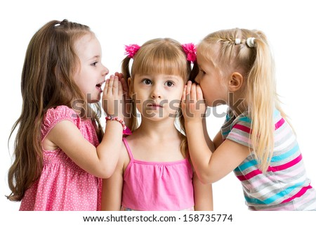 kids girlfriends sharing a secret isolated - stock photo
