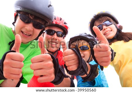 Kids giving thumbs up - stock photo