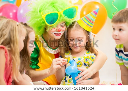 kids group and clown on birthday party - stock photo