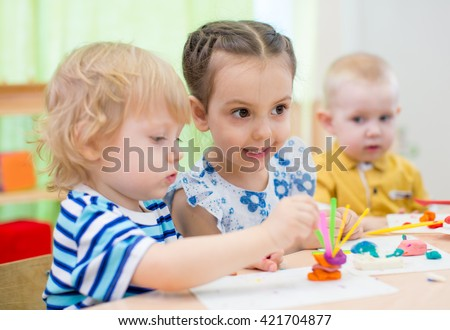kids group doing arts and crafts in kindergarten