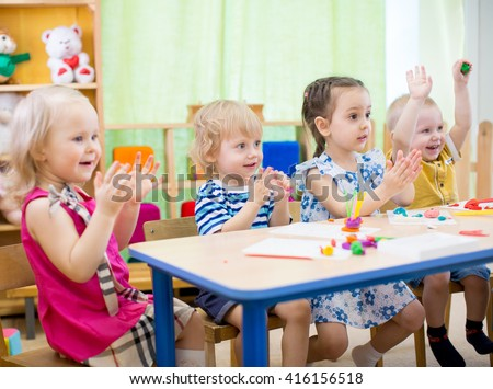 kids group learning arts and crafts in day care centre - stock photo