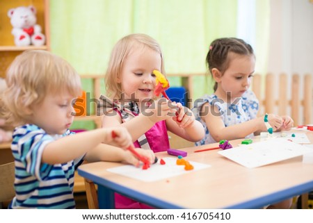 kids group making arts and crafts in kindergarten with interest - stock photo