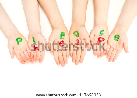 Kids hands begging and painted with the words please help.