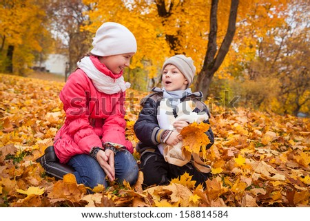kids having fun in autumn park