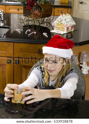 Kids having fun in the kitchen baking cookies and christmas treats