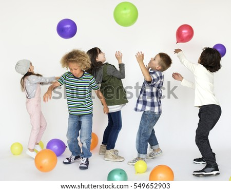 Kids having fun playing with party balloons
