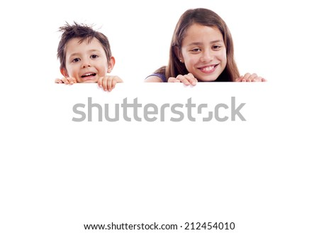 Kids holding a white board for text or image, isolated on white background - stock photo