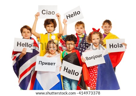 Kids holding greeting signs in different languages - stock photo